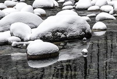 Boulders covered in snow